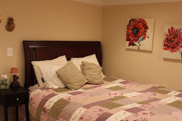 Your private basement bedroom, queen size Sleep Number Bed