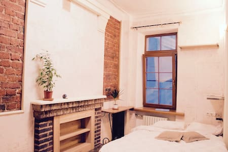 room in an old loft near Red Square - Apartment