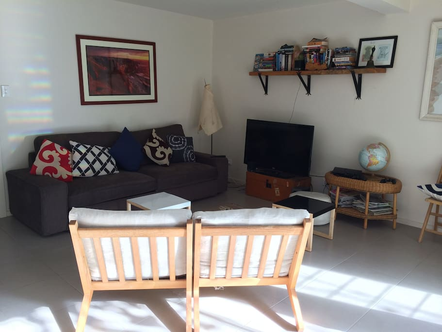 Living area with comfy queen sofa bed for overnight visitors or an extra child. North facing so full of sun in winter, but cool in summer.