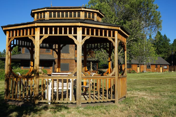 Gazebo, adjacent to pond with table and chairs, + WiFi for catching up on work.