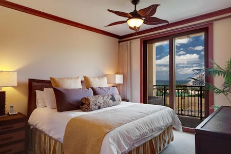 Master bedroom with slider to private Lanai and Ocean Views.