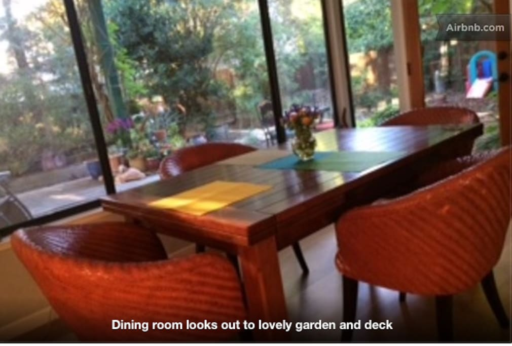 Dining room looks out over deck and garden