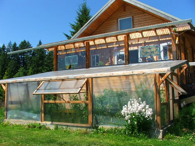 Main house with passive solar heating room and greenhouse