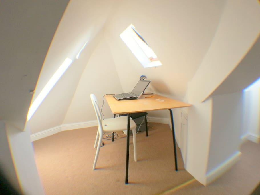 The loft room has a little office