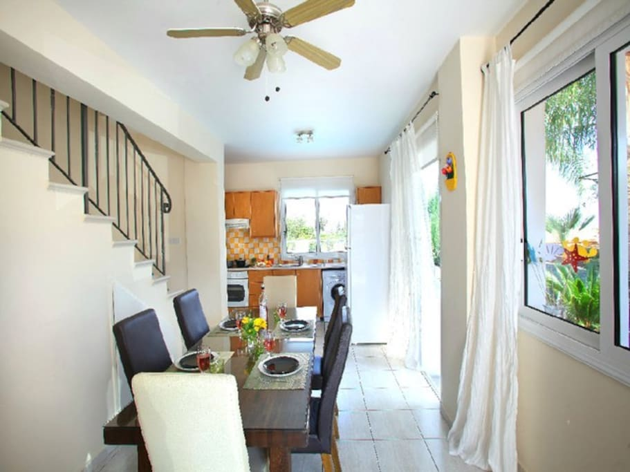 Main area, open plan living room with 2 sofas (one is double sofa bed), big dining table and a fully equipped kitchen where you can prepare your meals