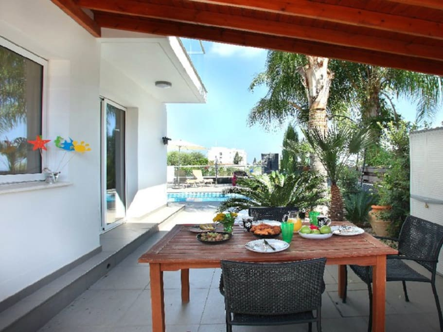 outside side area, with table and chairs where you can enjoy your breakfast before jumping into the swimming pool