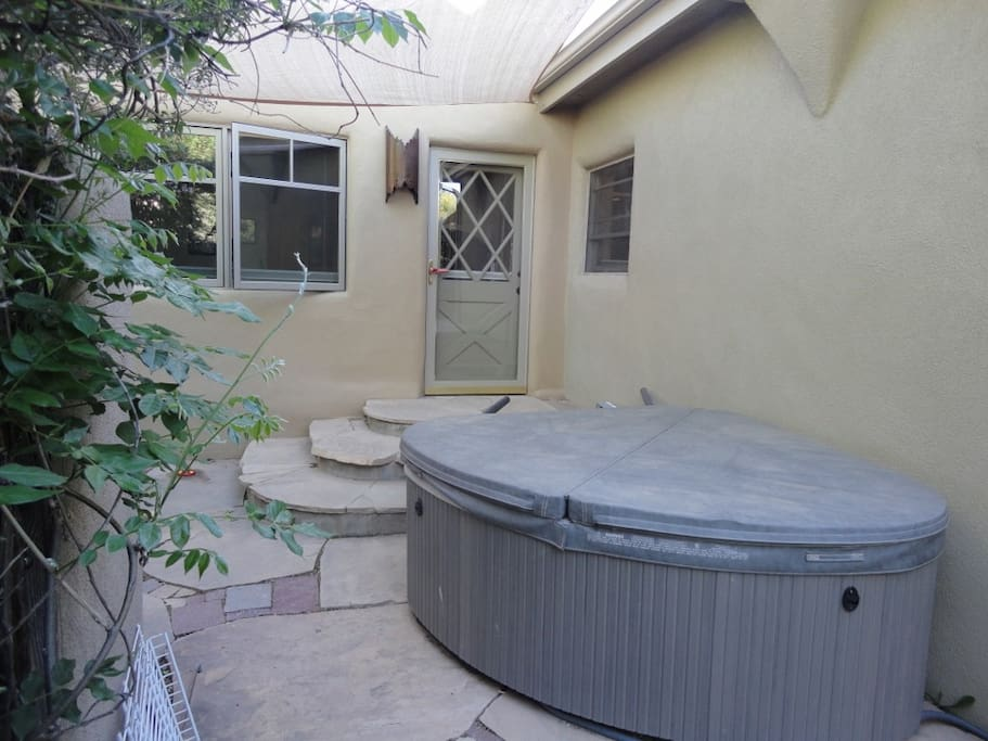 Outdoor two person hot tub off master bedroom, walled private courtyard