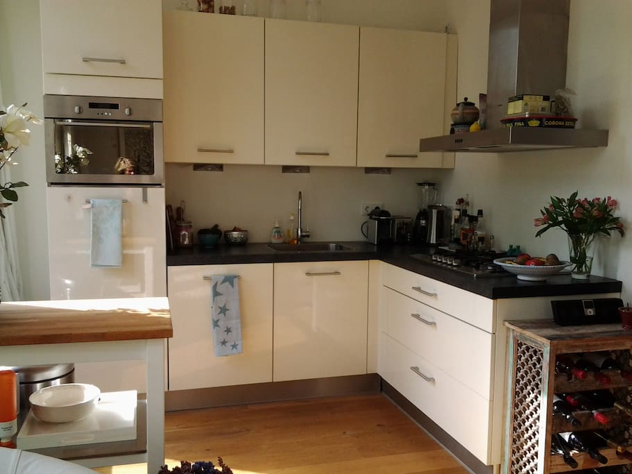 kitchen with dishwasser,microwave and oven.