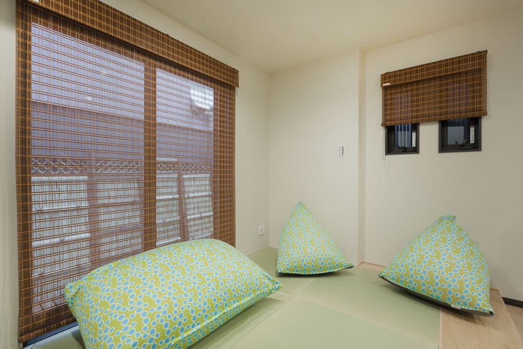 This is 1F bedroom section, with lots of sunshine and with tatami floor. Blankets are provided and stored within the shelves.