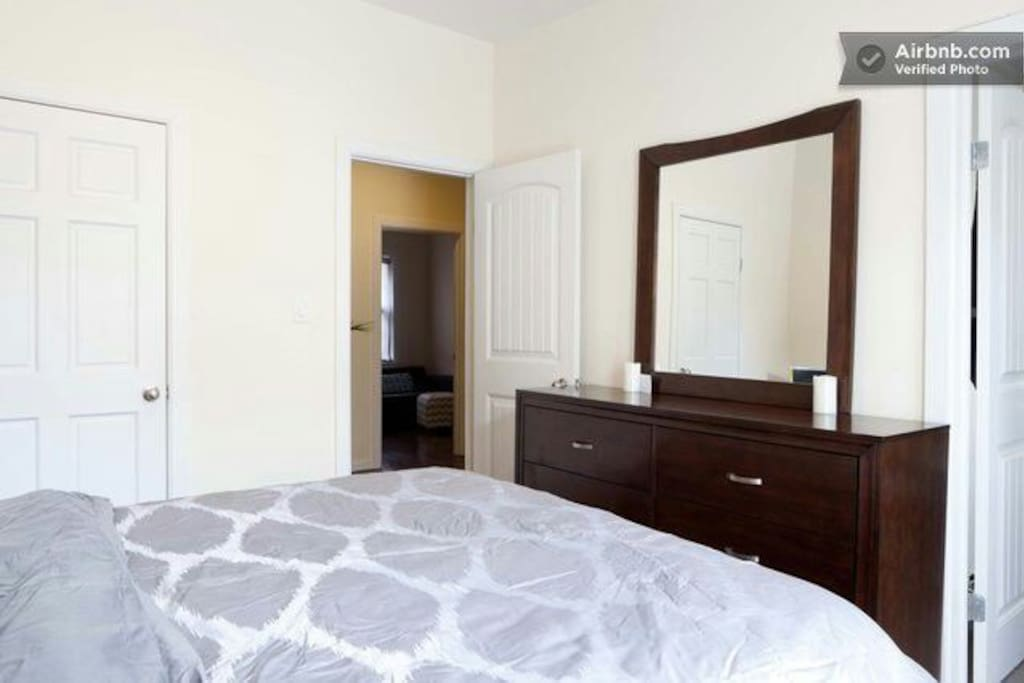 Bright Bedroom with door to private outdoor area.