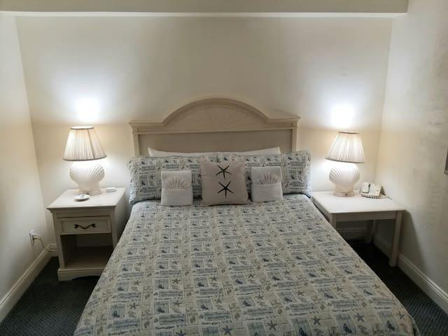 Queen sized bed in bedroom.