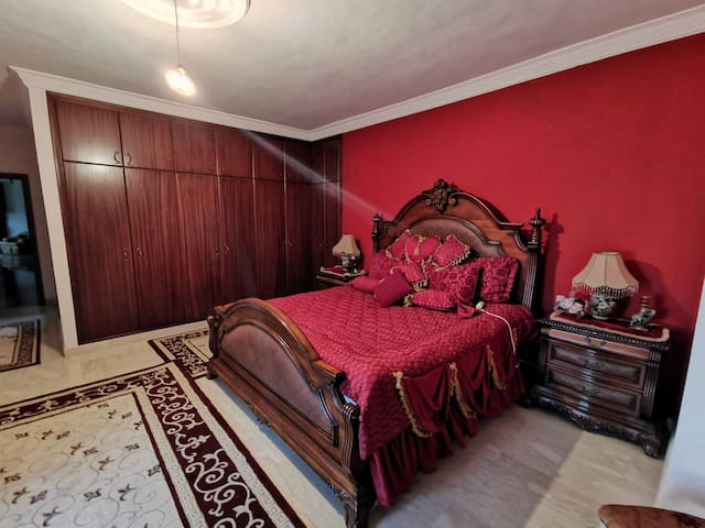 King Bed large Bedroom with a private toilet and balcony overlooking the woods, sea, and the village (angle2)