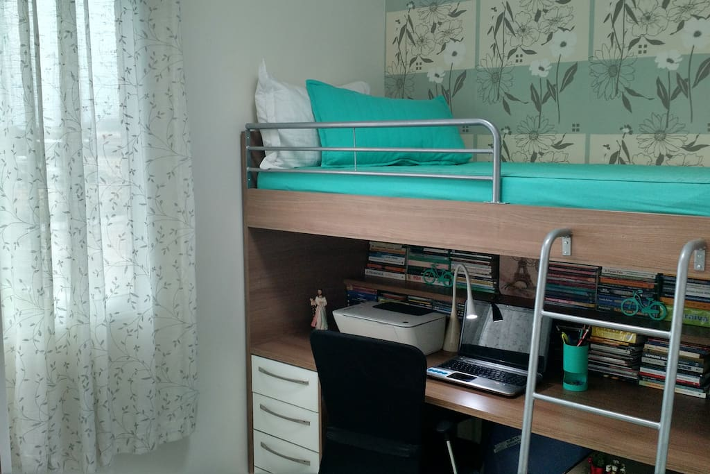 The Bedroom: Single bed with a desktop under it.