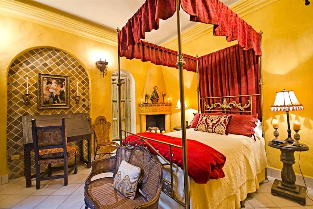 Your private four-poster bedroom boasts a fireplace and desk with WiFi.
