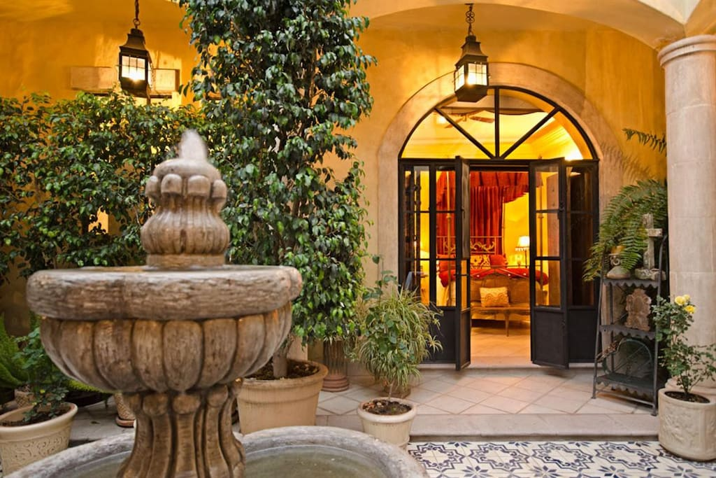 Enjoy the soothing fountain only steps from your bedroom's French doors!