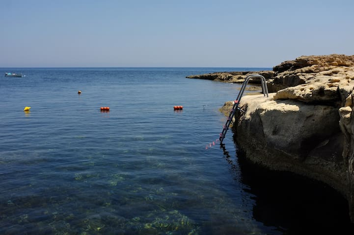 Crystal clear sea and many swimming spots just across the road