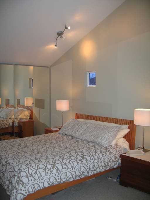 Huge master bedroom has vaulted ceilings and great five-piece master bath.