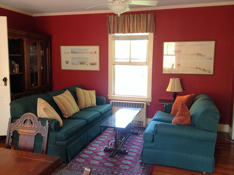 The lounge area of The Den has comfy couches and plenty of sunlight, inviting you to curl up with a book or play a game.