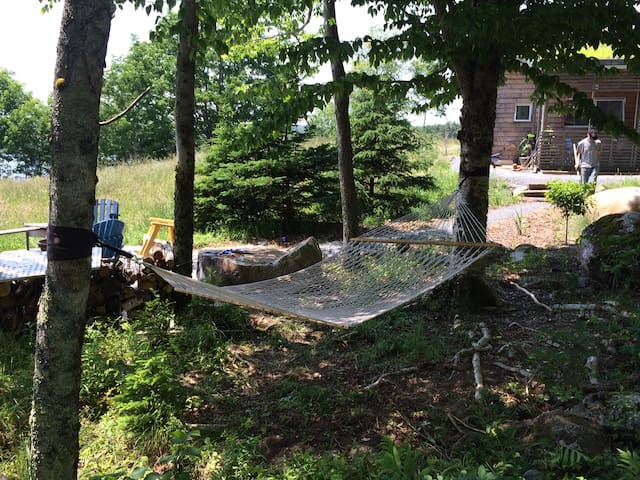 Hammock for two in the shade makes for a perfect afternoon siesta.