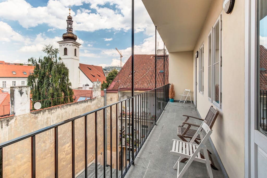 Cozy balcony with a view on the classical Prague's inner garden