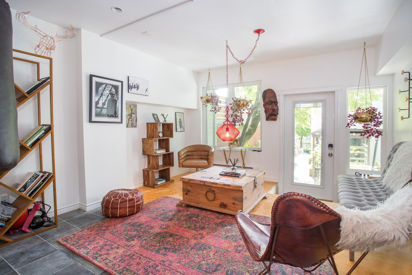 An eclectic and open concept artist's den with plenty of natural light