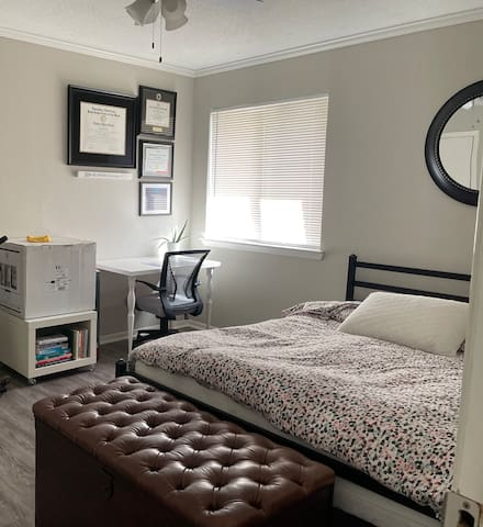 The spacious bedroom includes a desk with desk chair to comfortably work or study near a north facing window.