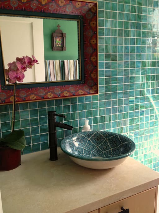 Colorful, private guest bathroom.
