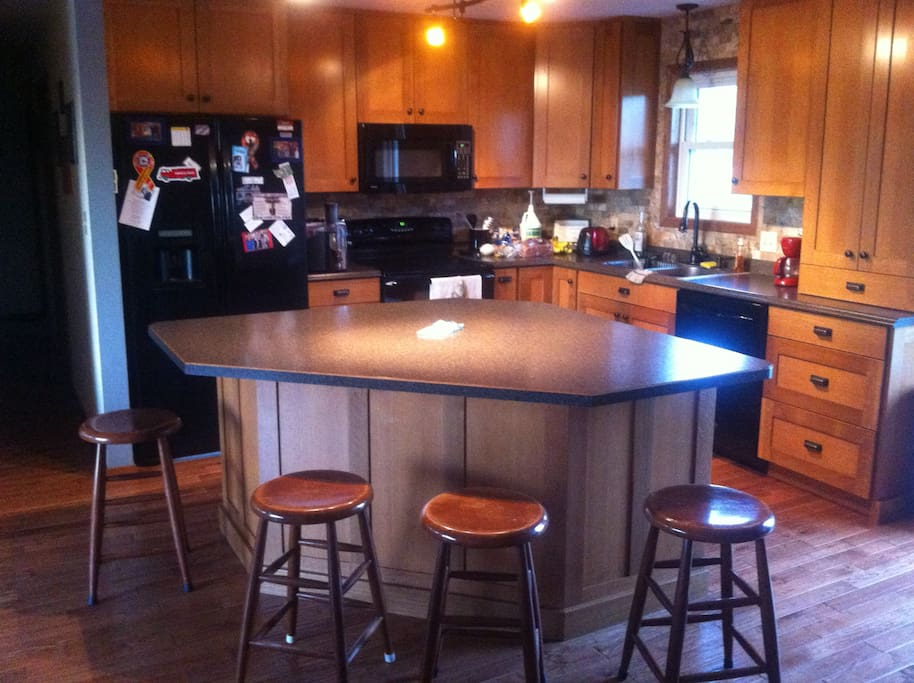 Seating for 5 at the Island, large fridge, double stove, microwave, dish washer