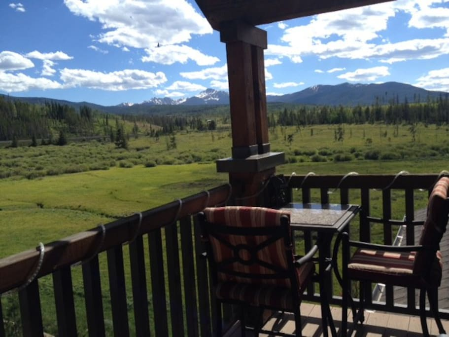 View from the deck (meadow and mountains)
