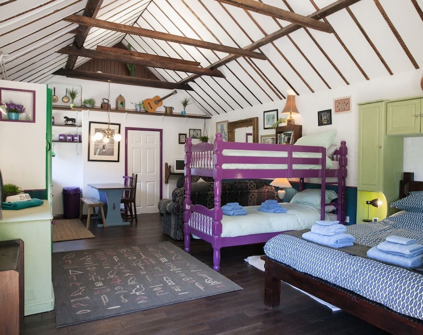 Open plan with a King size bed & bunk beds.
