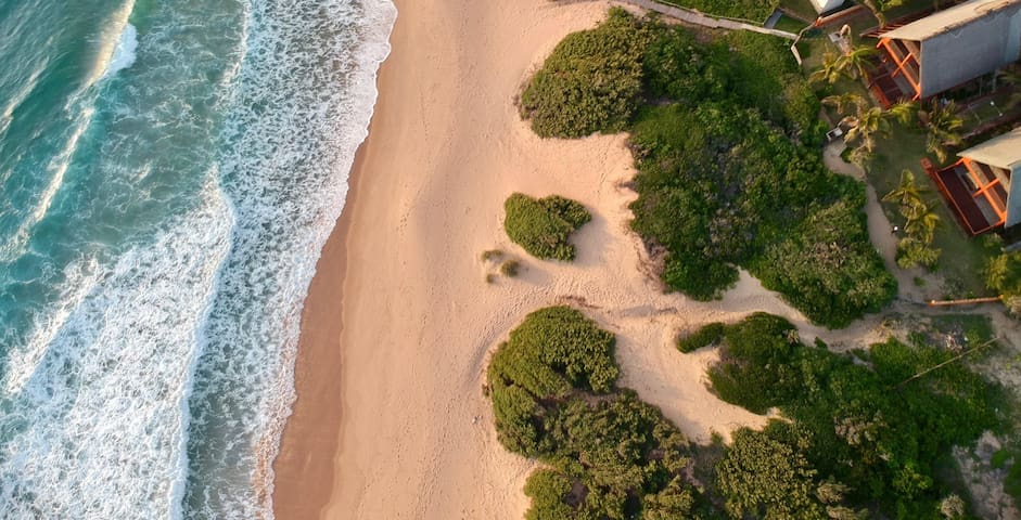 Drone shot of the house and the beach directly out in front - ideal spot