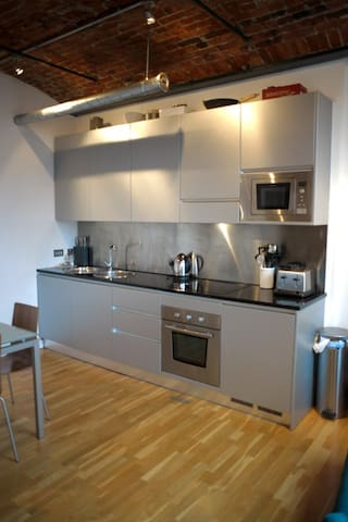 loft style kitchen/living room with balcony over leeds-liverpool canal, floor to ceiling windows