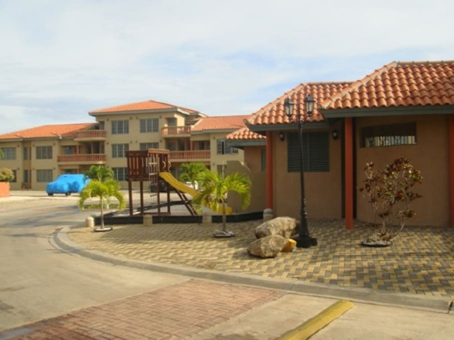 Clubhouse and playgrounds at Palma Real residential complex Clubhouse and playgrounds at Palma Real residential complex