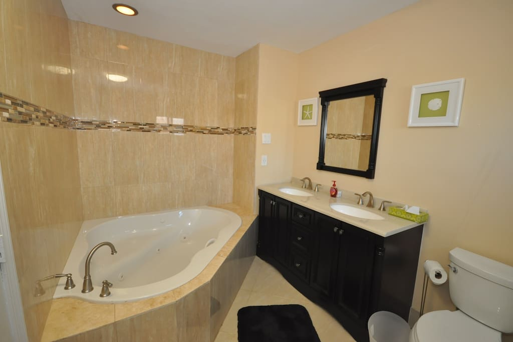 Newly renovated bathroom with Jacuzzi and shower stall