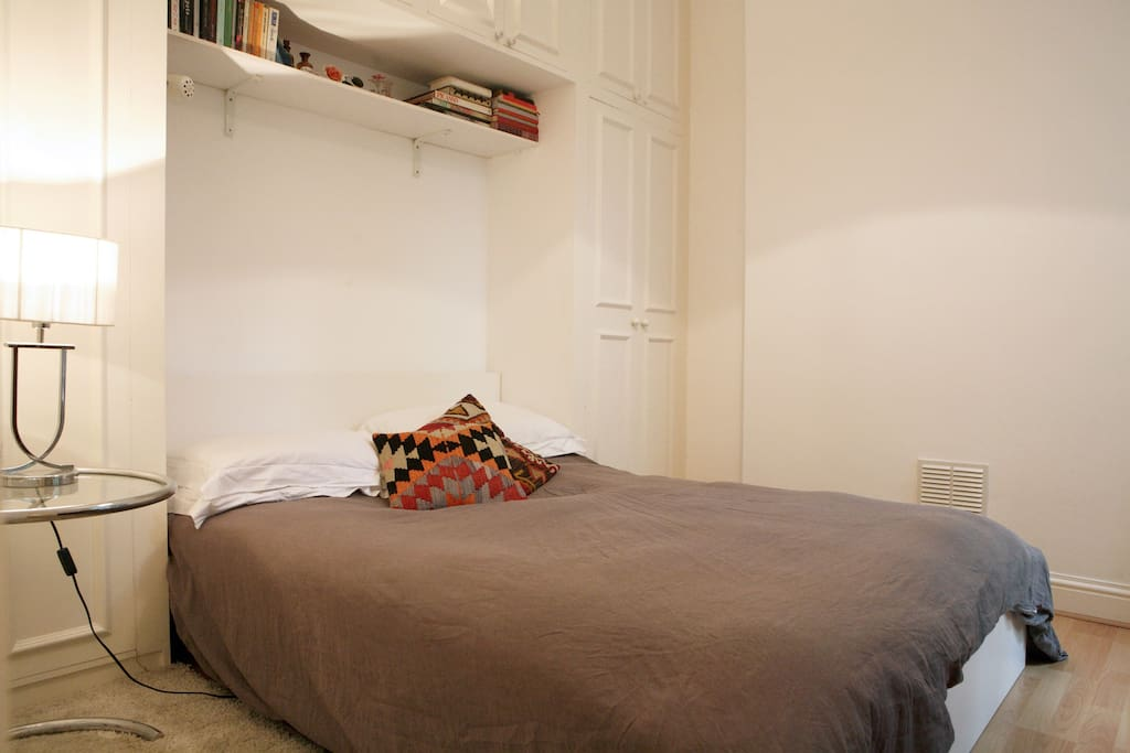 Double bed in cosy enclave