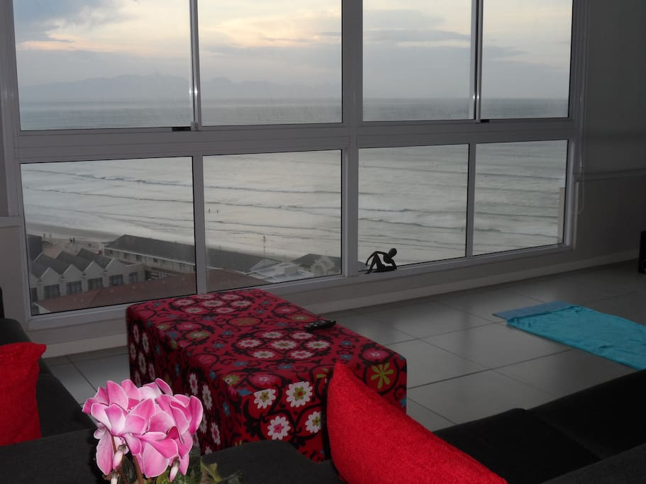 Floor to ceiling windows overlooking False Bay