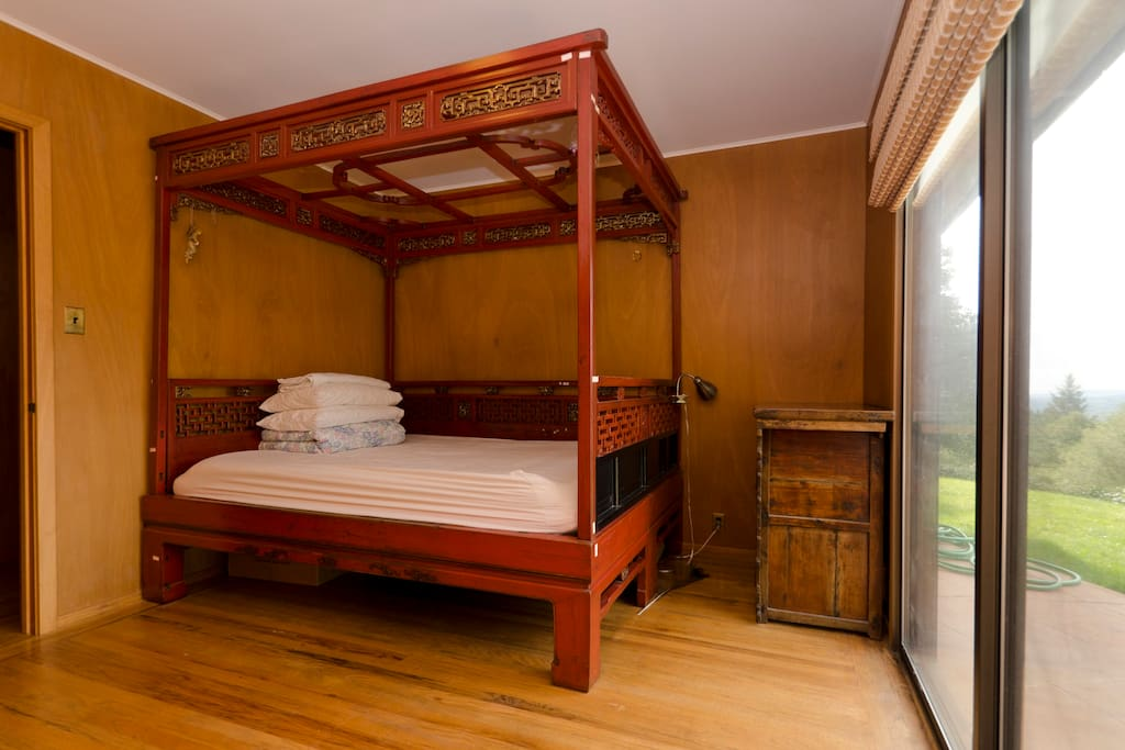 Guest bedroom with queen size Chinese antique wedding bed