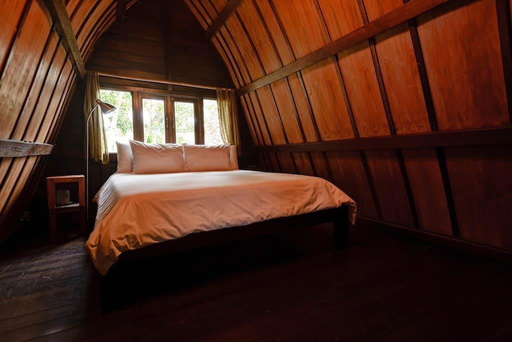 The upstairs bedroom has views to the rice paddies beyond.
