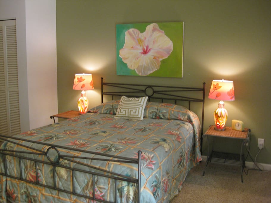 Queen bed is firm and comfortable, with ceiling fan and AC, plus fresh island breeze!
