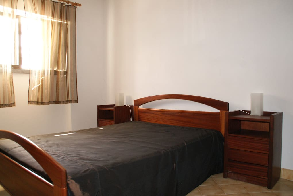 Room with double bed and wardrobe