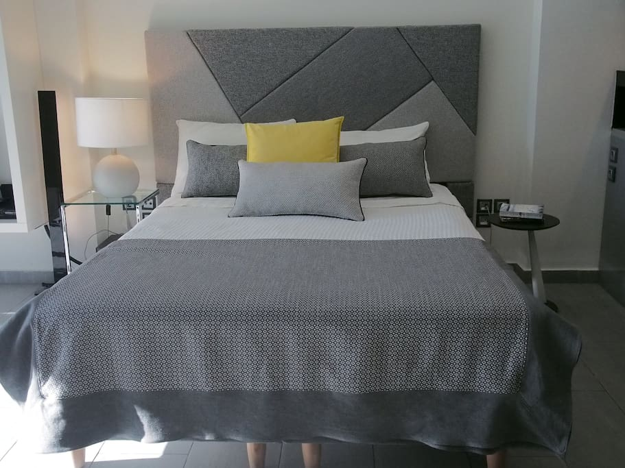 Double bed, super comfy made from the best materials to help you relax after a day walking in Athens!
