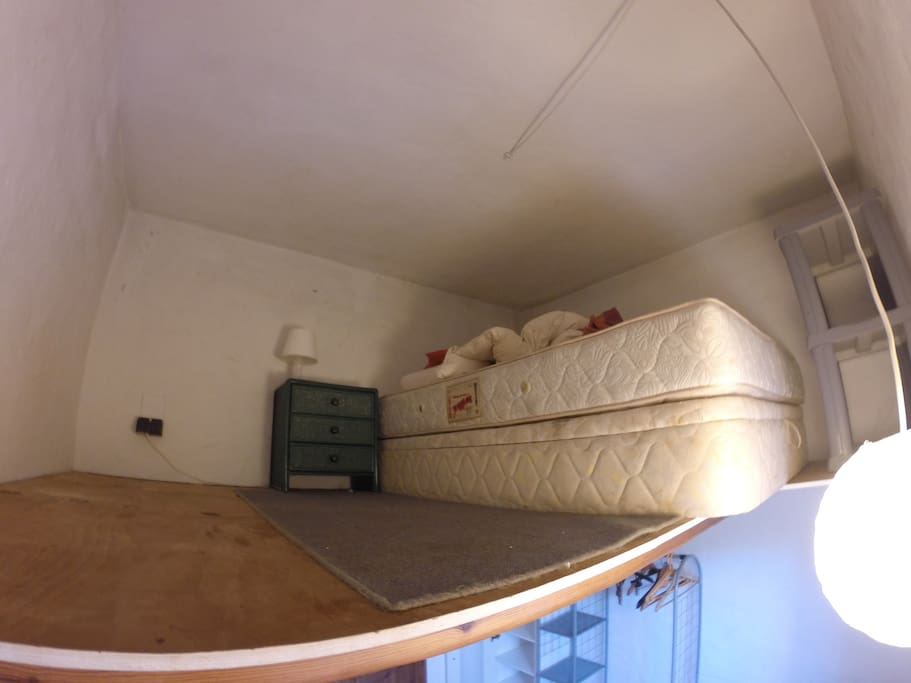 second level with a double bed (storage inside) - careful, room only 1,40m in height! :)