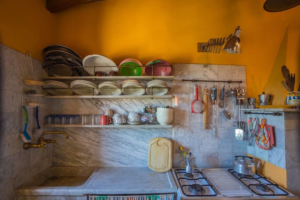 The well-stocked kitchen for cooking the best dishes of the Ligurian tradition