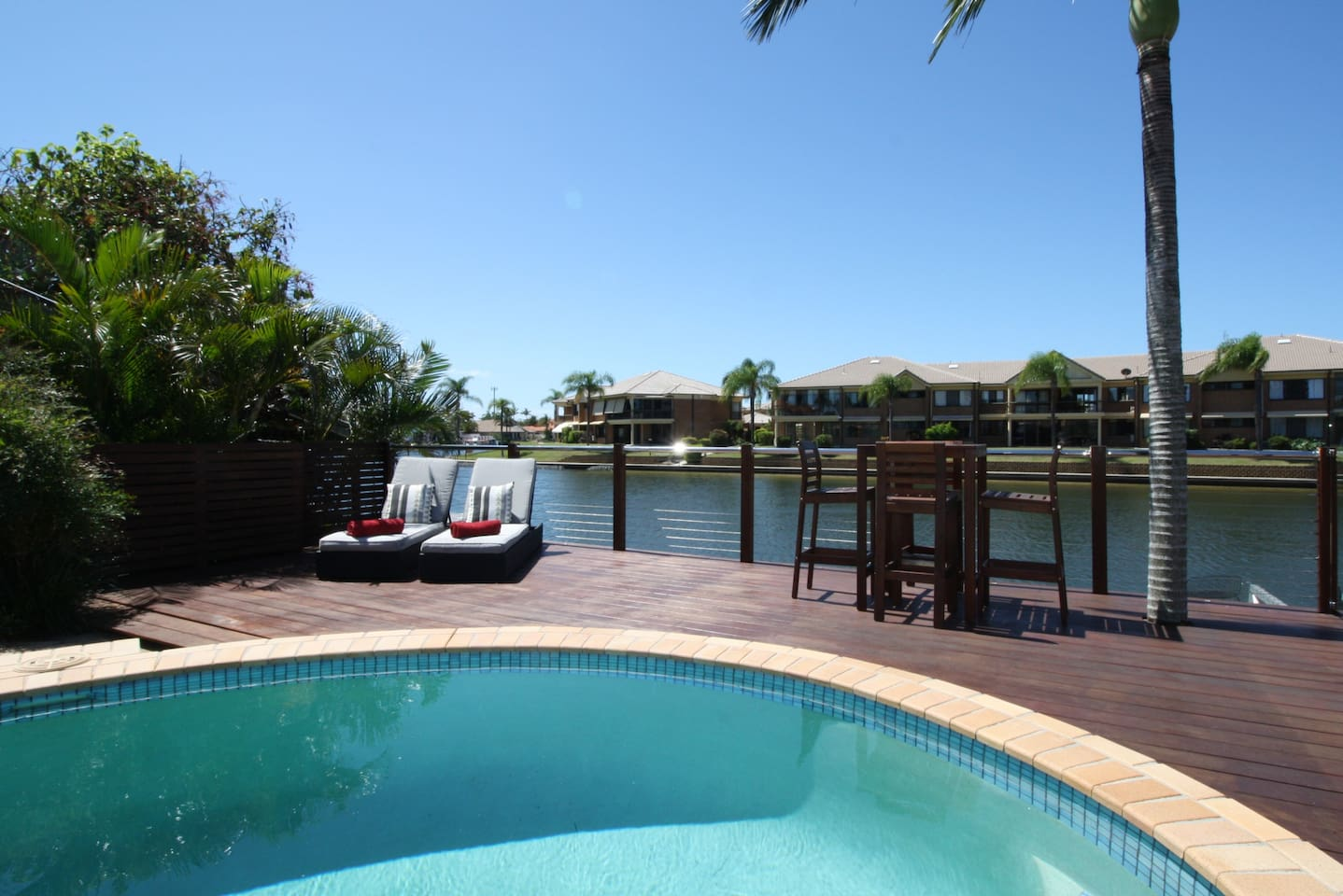 Relax by the refreshing pool overlooking the canal.
