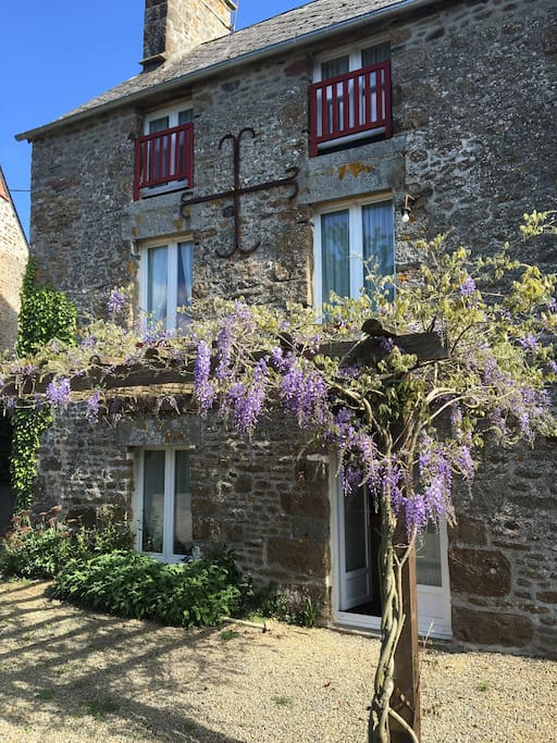 Back of house in the spring - perfect for al fresco dining