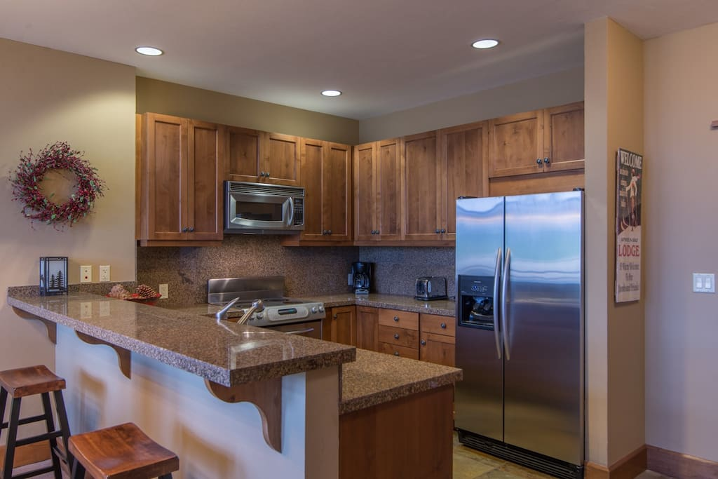 kitchen with granite counter tops, stainless steel appliances and all the tools you need to fix a gourmet dinner
