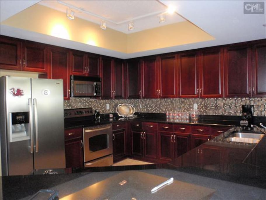 Kitchen area fully equipped. granite counter tops stainless steel appliances