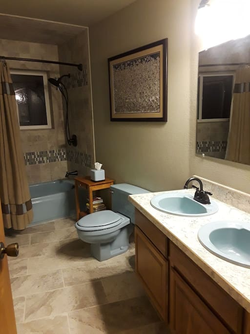 Private bathroom with double sinks