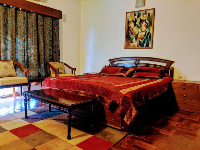 Super Deluxe Room with AC, TV  and attached bathroom