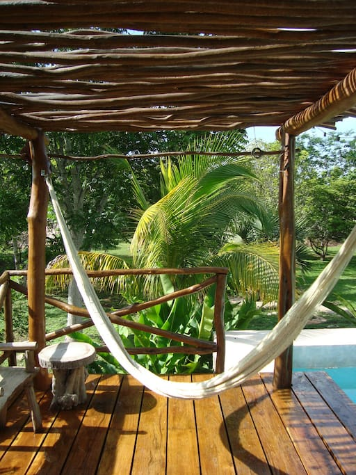 Enjoy a siesta in the hammock on the deck overlooking the antique water tank.
